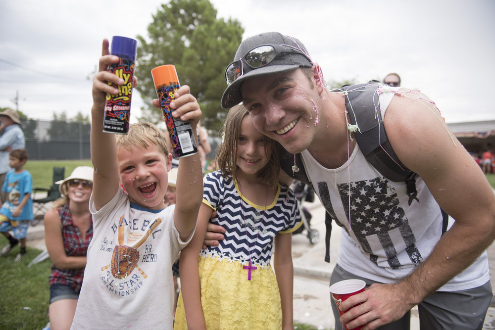 From left, Brayden Bell, 5, Kaylee Bell, 8, and their father Danny Bell, pose for a photo while covered in Silly String in Broadbent Park at the 67th Annual Boulder City Damboree Celebration in Boulder City, Saturday, July 4, 2015.(JASON OGULNIK/BOULDER CITY REVIEW)