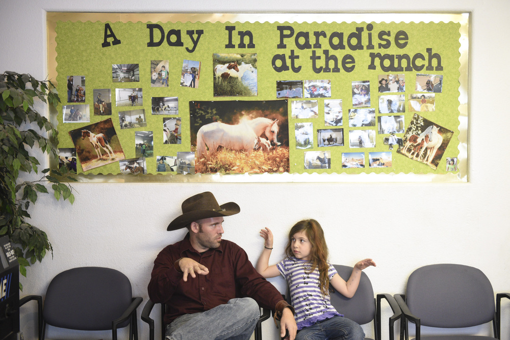 Paradise Rancher owner, Paul Roger's and his 7 year old daughter, Laura Rogers, right, sit in the office at Paradise Ranch in Las Vegas, Monday, June 1, 2015. (Jason Ogulnik/Las Vegas Review-Journal)