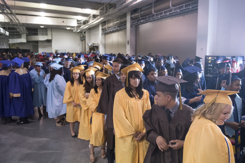 Students gather backstage during the Clark County School District's summer commencement ceremony at Orleans Arena in Las Vegas, Tuesday, Aug. 18, 2015. (Jason Ogulnik/Las Vegas Review-Journal)