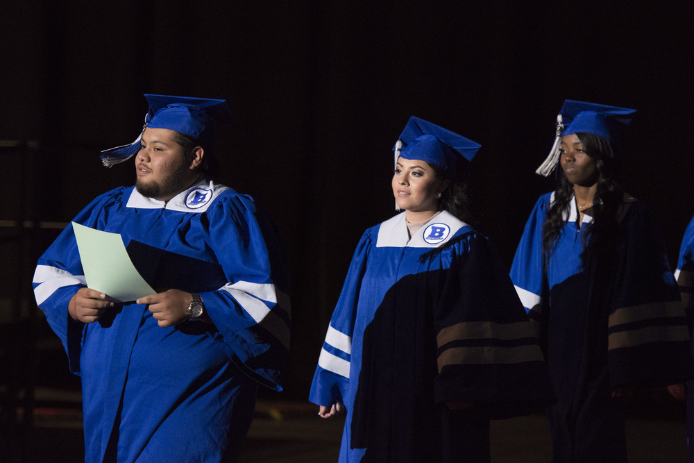 Basic High School graduates, Michael Del Rio, Lesley Garcia, and Brejon Grays prepare to take their seats during the Clark County School District's summer commencement ceremony at Orleans Arena in Las Vegas, Tuesday, Aug. 18, 2015. (Jason Ogulnik/Las Vegas Review-Journal)