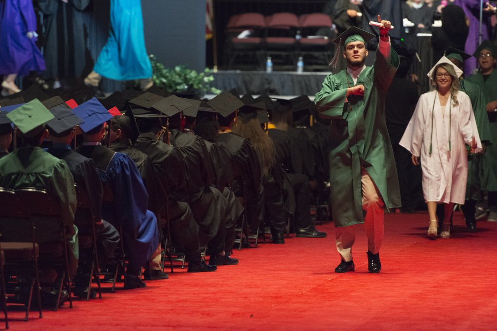 Newly graduated students collect their diploma during the Clark County School District's summer commencement ceremony at Orleans Arena in Las Vegas, Tuesday, Aug. 18, 2015. (Jason Ogulnik/Las Vegas Review-Journal)