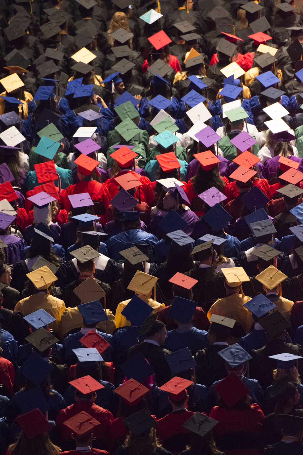 Newly graduated students are shown during the Clark County School District's summer commencement ceremony at Orleans Arena in Las Vegas, Tuesday, Aug. 18, 2015. Each color of cap and gown represent a different high school. (Jason Ogulnik/Las Vegas Review-Journal)