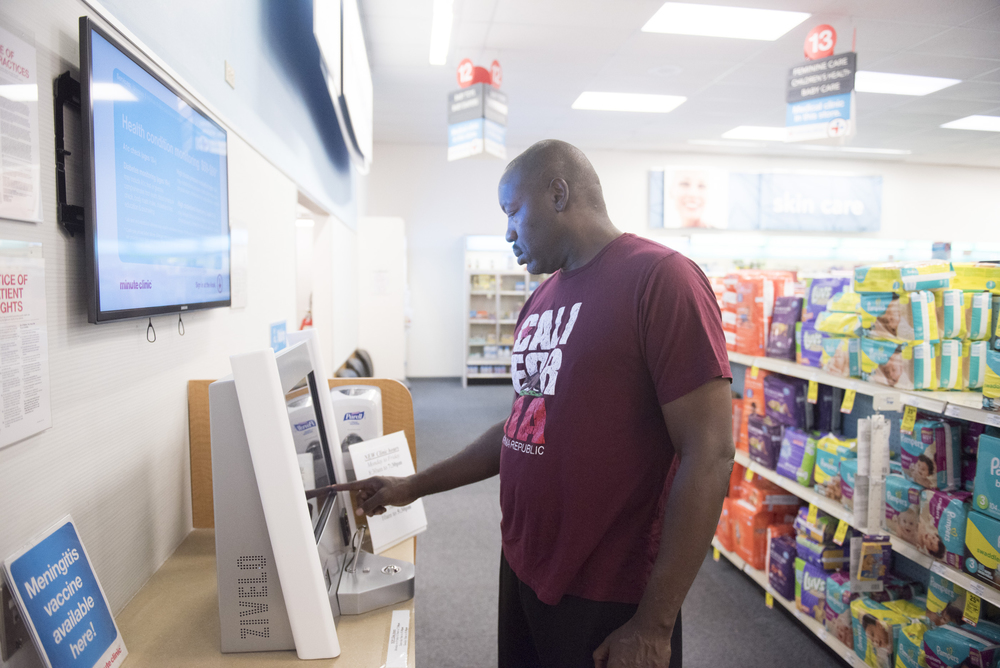 Anthony Howard signs up for an appointment at the self check-in kiosk at CVS Pharmacy's Minute Clinic at 1825 East Warm Springs Road in Las Vegas, Thursday, Aug. 13, 2015. Howard visits the clinic to have a physical for a driving position with the Department of Transportation.(Jason Ogulnik/Las Vegas Review-Journal)