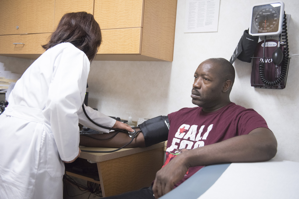 Anthony Howard, right, has his blood pressure checked by nurse practitioner Yvette Alto-Buenaflor at CVS Pharmacy's Minute Clinic at 1825 East Warm Springs Road in Las Vegas, Thursday, Aug. 13, 2015. Howard visits the clinic to have a physical for a driving position with the Department of Transportation.(Jason Ogulnik/Las Vegas Review-Journal)