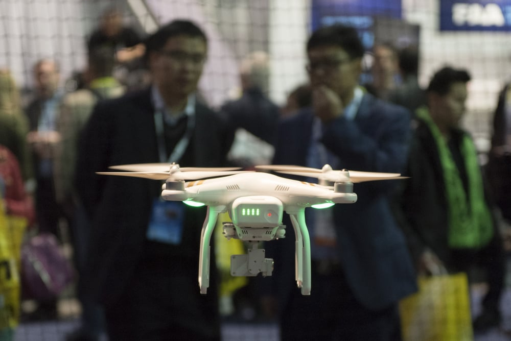 Convention attendees watch the DJI Phantom 3 Professional drone in flight during a demonstration at the DJI booth at the 2016 International Consumer Electronics Show (CES) in Las Vegas, Nevada, USA, 06 January 2016. Photo: Jason Ogulnik/dpa