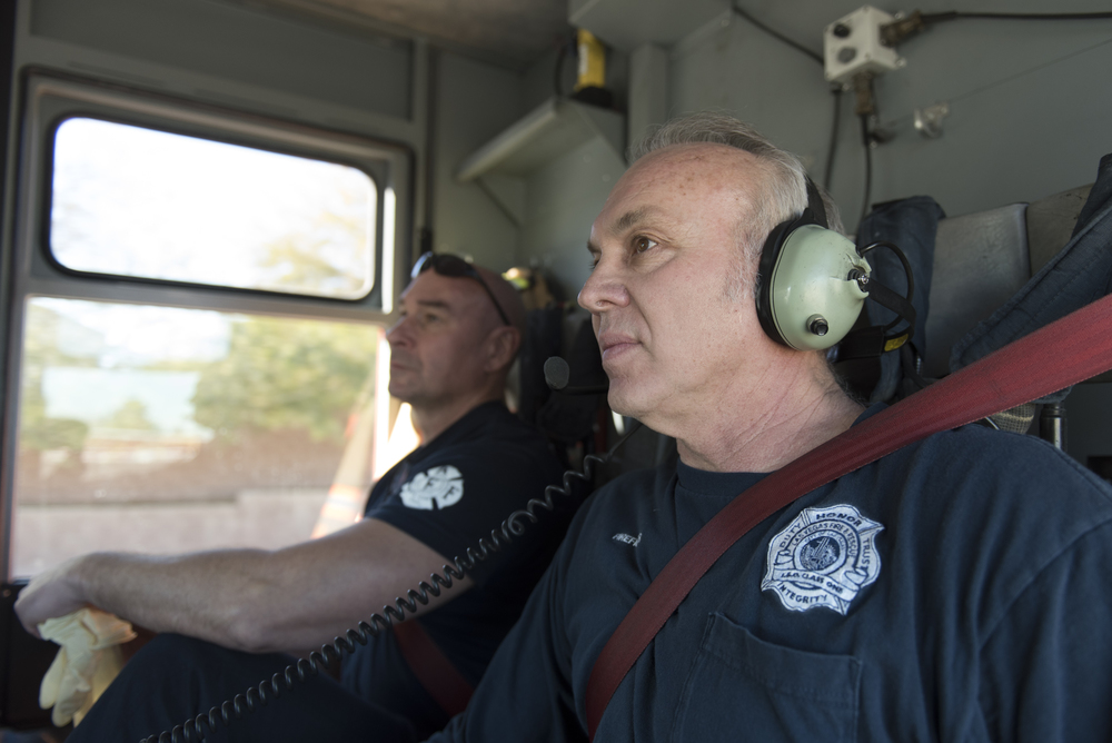 Las Vegas Fire & Rescue Fire Station 41 firefighters Ted Ramey, right, and Tony DiDona sit in a fire truck cab en route to an emergency call to a private residence in Las Vegas Monday, Jan. 11, 2016. Jason Ogulnik/Las Vegas Review-Journal