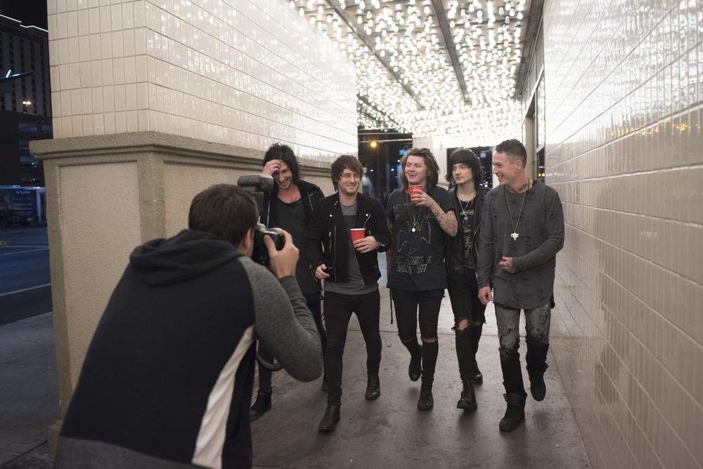 Andrew Lipovsky, left, photographs Asking Alexandria for a Kerrang! magazine photoshoot at The Plaza Hotel and Casino in Las Vegas Sunday, Feb. 7, 2016. Photo by Jason Ogulnik