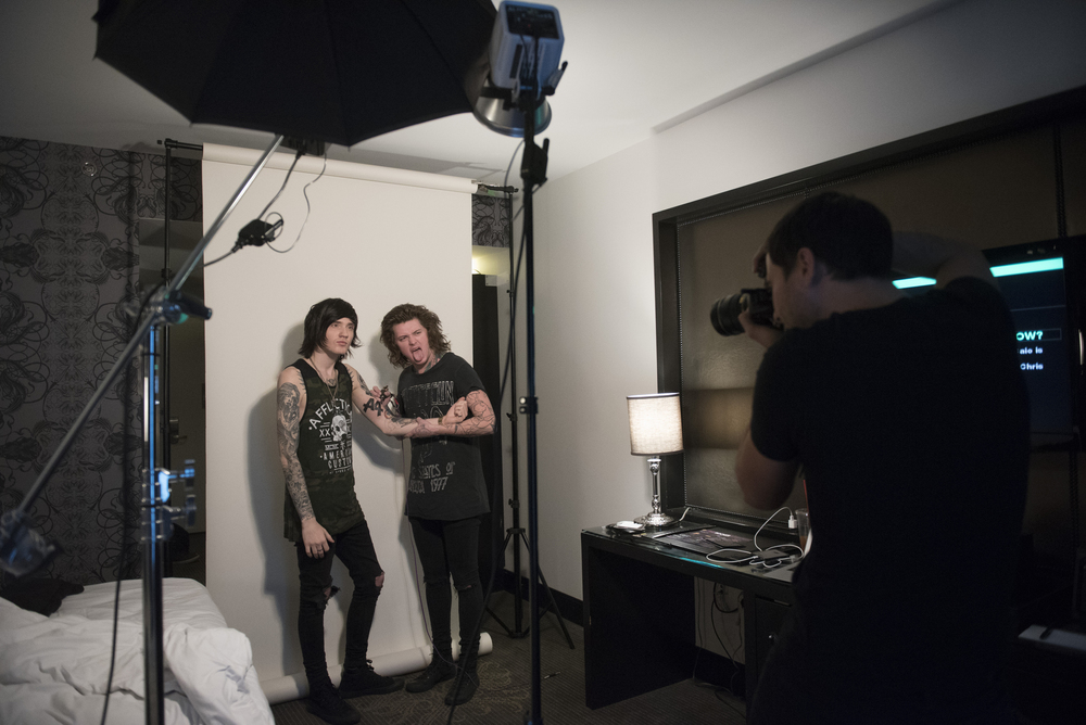Andrew Lipovsky, right, takes a photo of Asking Alexandria's Denis Stoff, left, and Ben Bruce for a Kerrang! magazine photoshoot at Hart & Huntington Tattoo at Hard Rock Hotel & Casino in Las Vegas Saturday, Feb. 6, 2016. Photo by Jason Ogulnik