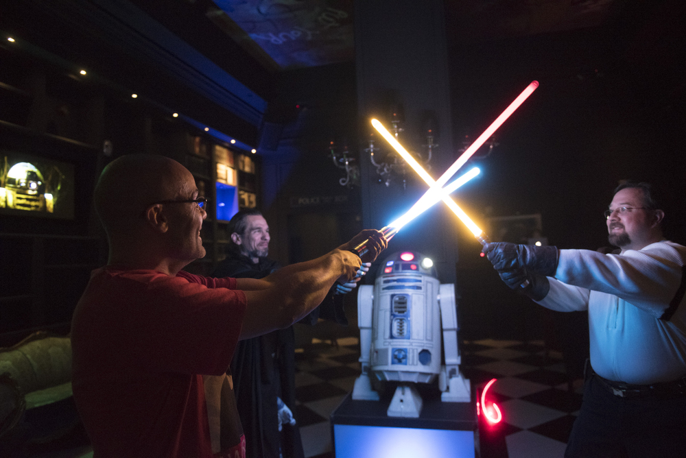 Alex Pusineri, owner of Millennium Fandom Bar, left, Steven See, center, and Gabriel Colbaugh demonstrate their lightsabers during a Star Wars themed night at the bar at 900 Las Vegas Blvd. South in Las Vegas Saturday, Feb. 27, 2016. Jason Ogulnik/Las Vegas Review-Journal