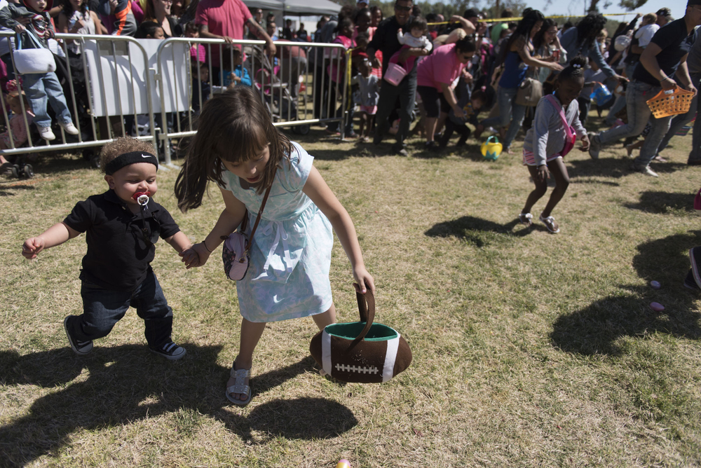 Darvell Hill, 1, left, is helped by Micaela Azevedo, 9, in collecting easter eggs during the 3rd annual Easter Festival at Craig Ranch Regional Park in North Las Vegas Saturday, March 26, 2016. The Christian Hope Project and the Las Vegas police Northeast Area Command helped to put on the event. Jason Ogulnik/Las Vegas Review-Journal