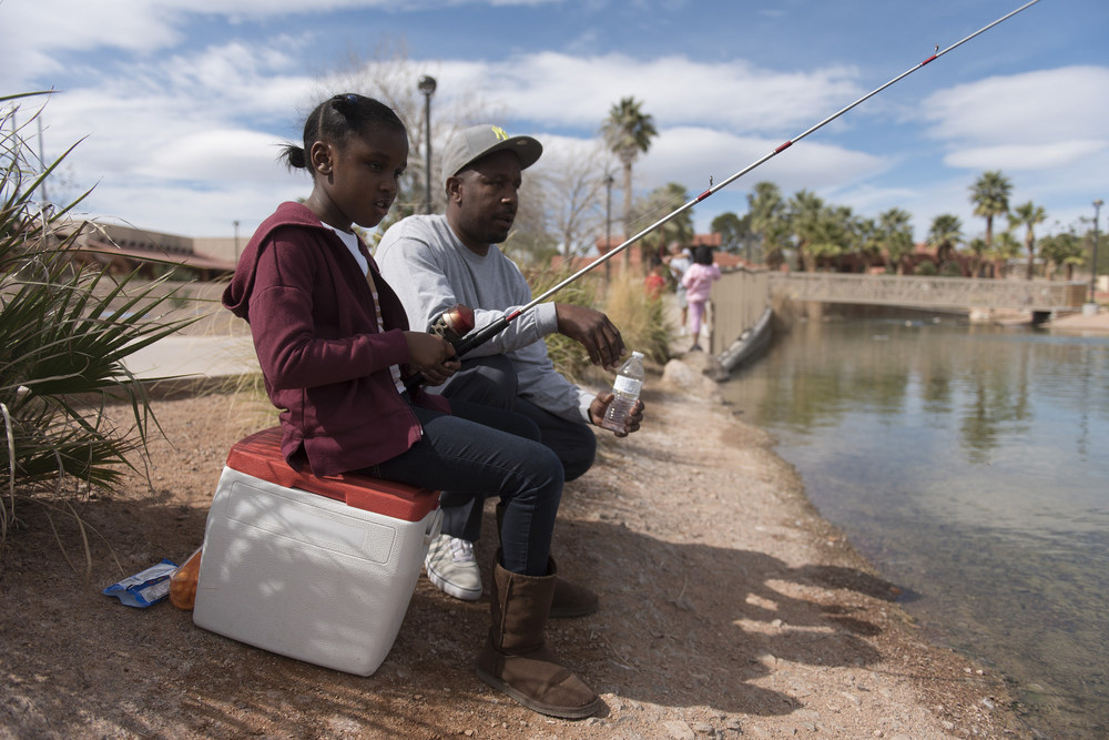 Seven-year-old Kenedie Crane, left, and her father Derrick Crane participate in the Councilman Ricki Y. Barlow Fishing Derby at Lorenzi Park at 3343 W. Washington Ave. in Las Vegas Saturday, March 5, 2016. Jason Ogulnik/Las Vegas Review-Journal