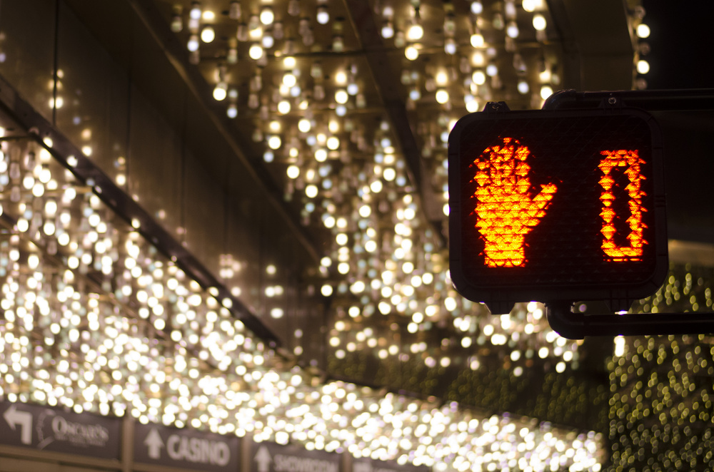 A pedestrian traffic signal counts down in front of the Plaza hotel and casino in downtown Las Vegas Wednesday, Nov. 25, 2015.