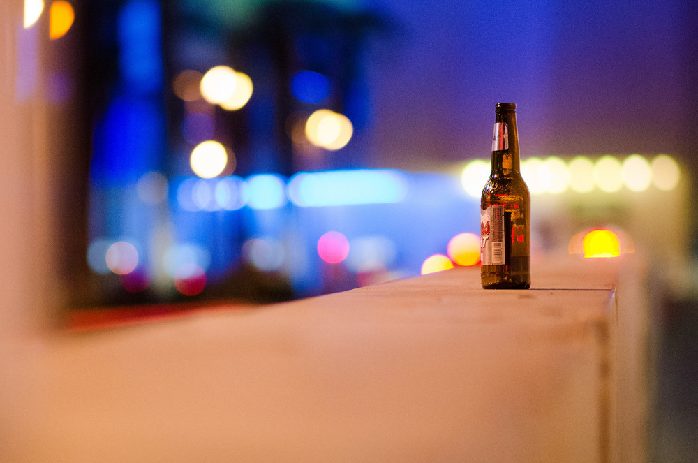 An empty beer bottle sits on a wall in front of Bally's hotel-casino in Las Vegas Wednesday, May 20, 2015.
