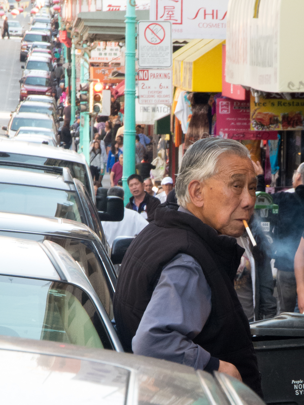 A man takes a cigarette break on Grant Street in San Francisco's Chinatown Monday, Aug. 19, 2013.