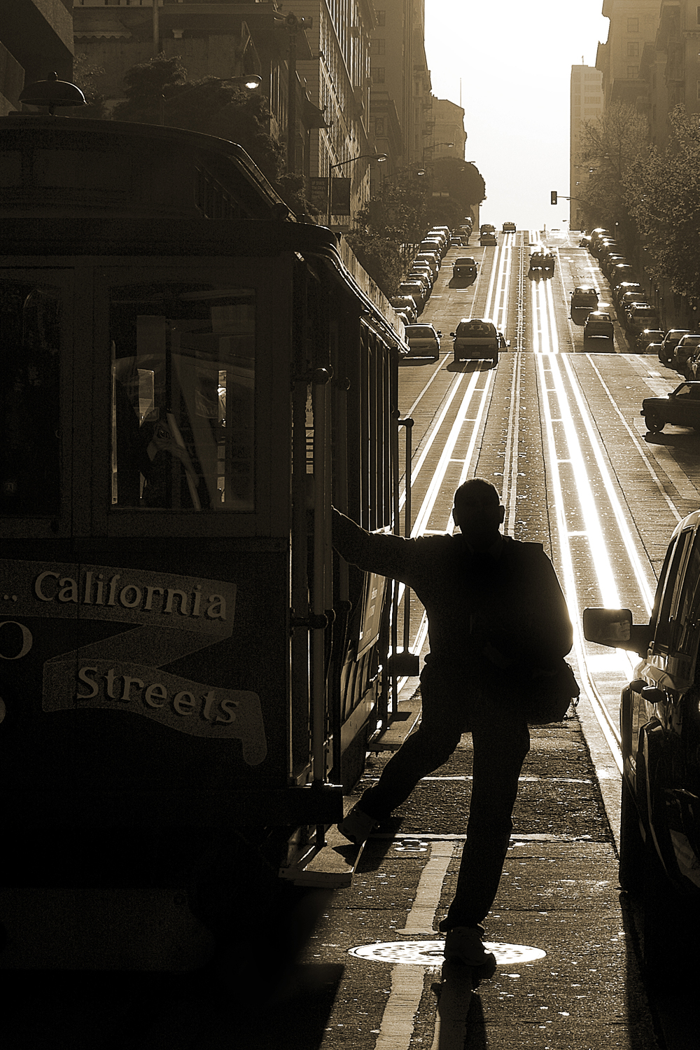 A man exits a cable car on the California Street - Van Ness Avenue line in San Francisco, Calif. Sunday, Mar. 29, 2009.
