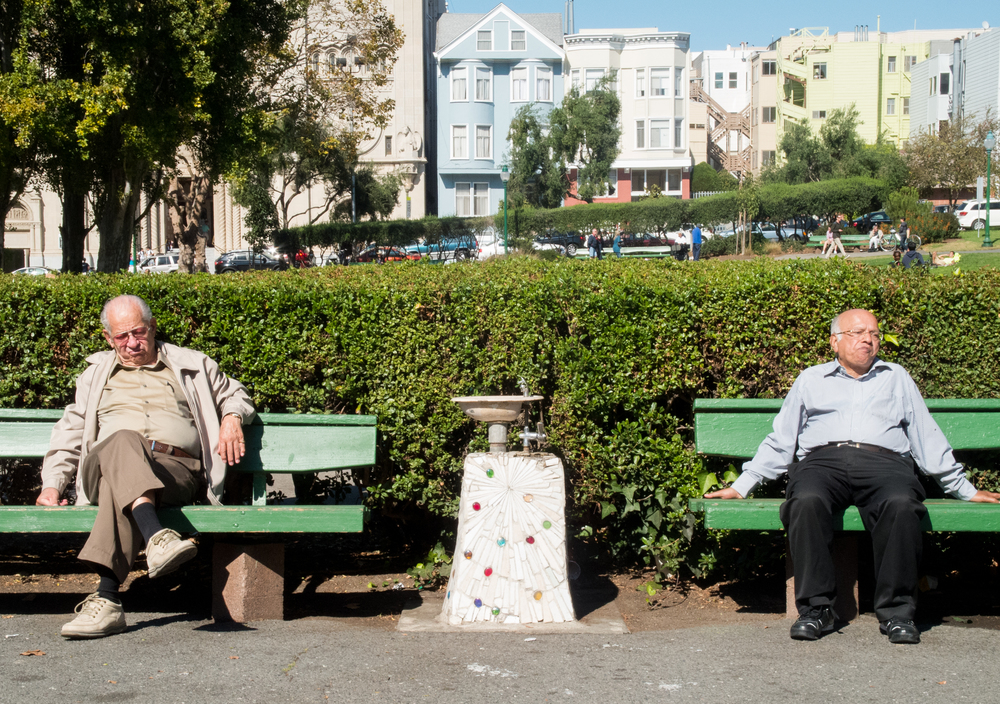 Two men sit on benches at Washington Square in San Francisco, Calif. Friday Oct. 13, 2013.