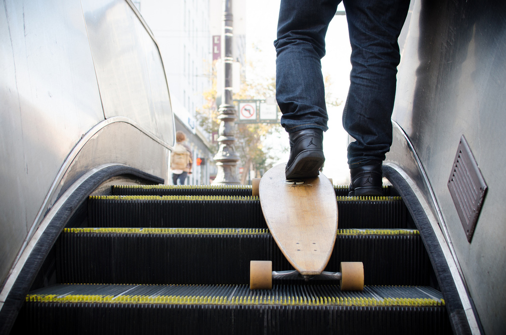 A skateboarder transitions from underground to street level at Civic Center Station in San Francisco, California.