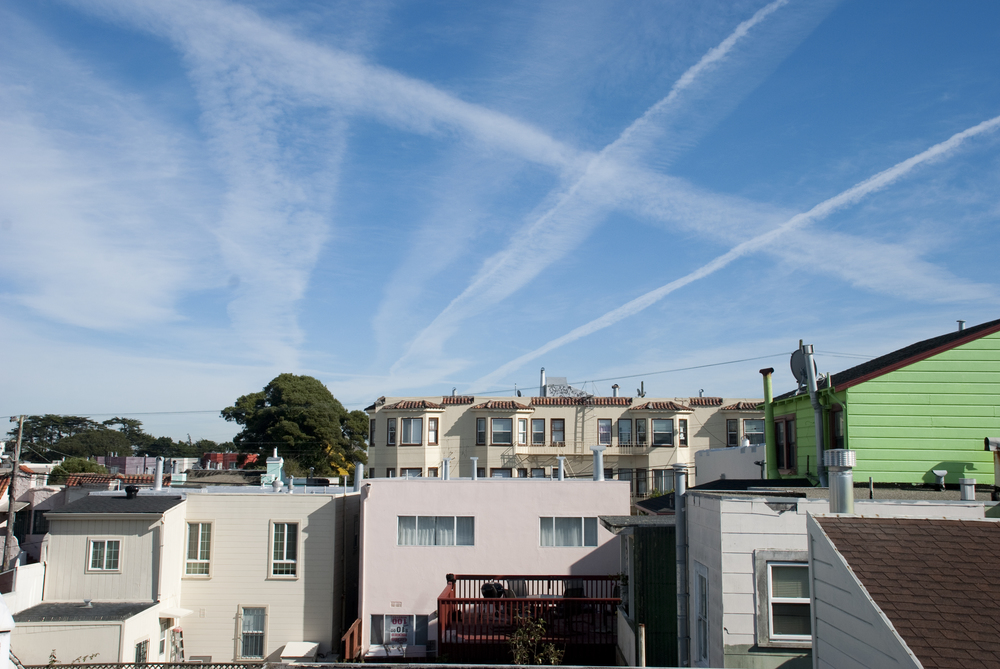 Contrails are spotted over San Francisco's Ingleside neighborhood Tuesday, Nov. 13, 2012.