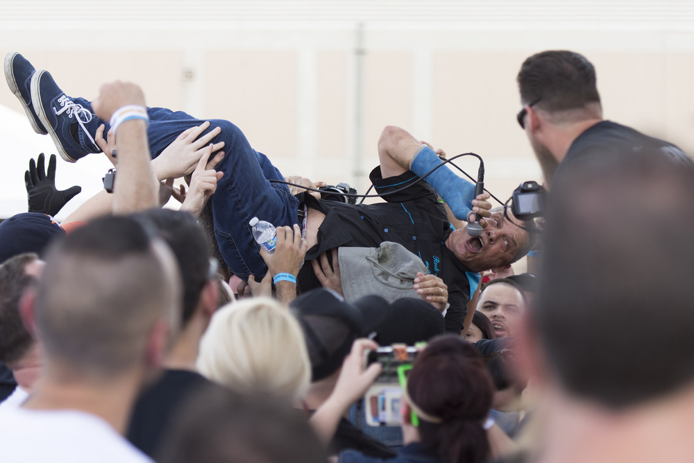Brian Brannon crowd surfs as he performs with JFA during the 18th annual Punk Rock Bowling & Music Festival in downtown Las Vegas Saturday, May 28, 2016.