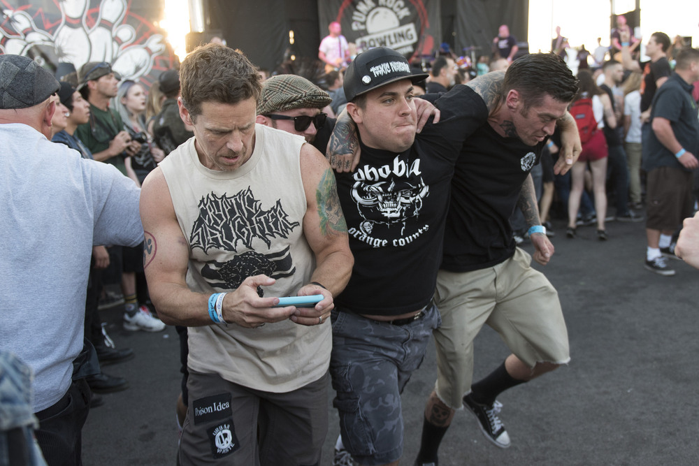 A Festivalgoer runs around the circle pit while holding their phone as The Bronx performs during the 18th annual Punk Rock Bowling & Music Festival in downtown Las Vegas Saturday, May 28, 2016.