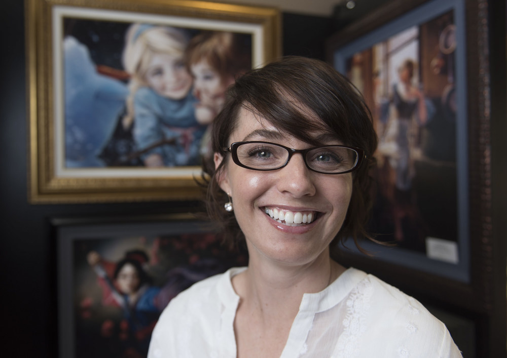 Artist Heather Theurer  poses with her work in Magical Memories Featuring Disney Fine Art at Town Square in Las Vegas Monday, May 23, 2016. Jason Ogulnik/Las Vegas Review-Journal