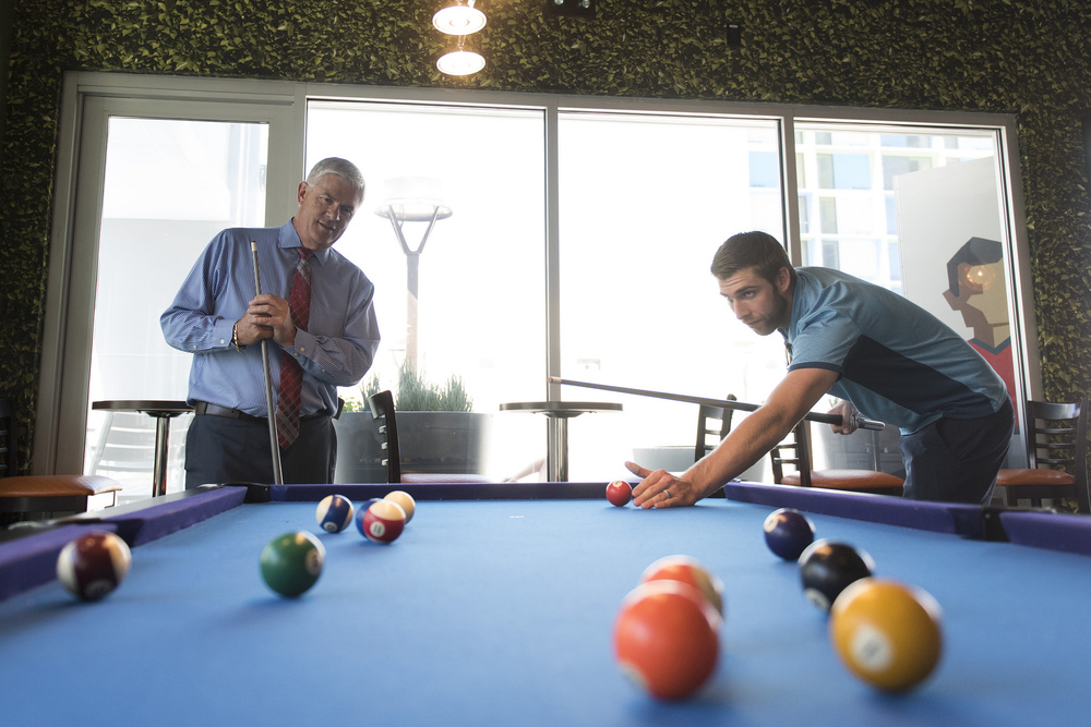 Mark Kelly, vice president of casino operations with Bally's, Paris and Planet Hollywood, left, and his son, Ryan Kelly, pool operations manager at The Linq Hotel, play a game of pool in the recreation room by the swimming pool at The Linq Hotel in Las Vegas Wednesday, June 1, 2016. Jason Ogulnik/Las Vegas Review-Journal