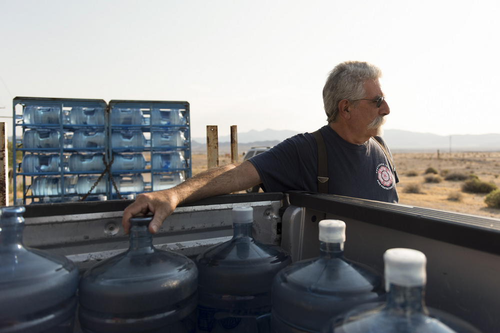 Larry Levy, fire chief with Southern Inyo Fire Protection District, makes his weekly potable water delivery rounds to residents in Tecopa, Calif. Tuesday, June 21, 2016. Jason Ogulnik/Las Vegas Review-Journal