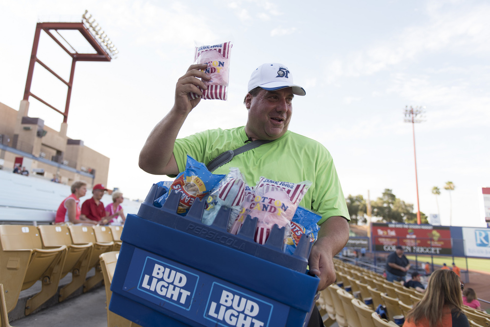 Hawker Bruce Reiner walks through the stands with more than 50 pounds of merchandise prior to a Las Vegas 51s baseball game at Cashman Field in Las Vegas Monday, June 27, 2016. Reiner has worked as a hawker at the field for more than 10 years. Jason Ogulnik/Las Vegas Review-Journal