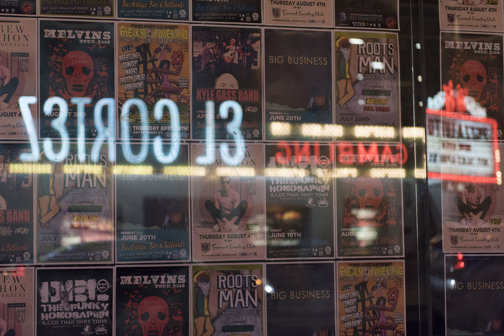 Concert posters line the window of Backstage Bar & Billiards at 601 Fremont St. in Las Vegas Friday, June 24, 2016. El Cortez hotel-casino is reflected on the window. Jason Ogulnik/Las Vegas Review-Journal