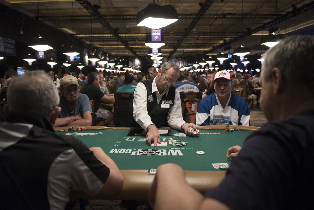 Ray Knee, center, deals during Day 1A of the Main Event of the World Series of Poker at the Rio Convention Center in Las Vegas Saturday, July 9, 2016. Jason Ogulnik/Las Vegas Review-Journal