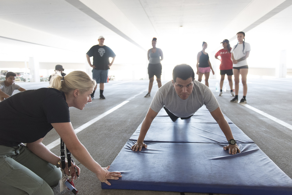 Carlos Vivanco, right, does push-ups during a recruiting boot camp at Las Vegas police headquarters in Las Vegas Saturday, June 25, 2016. Officer Stephanie Ward, left, supervises. Jason Ogulnik/Las Vegas Review-Journal