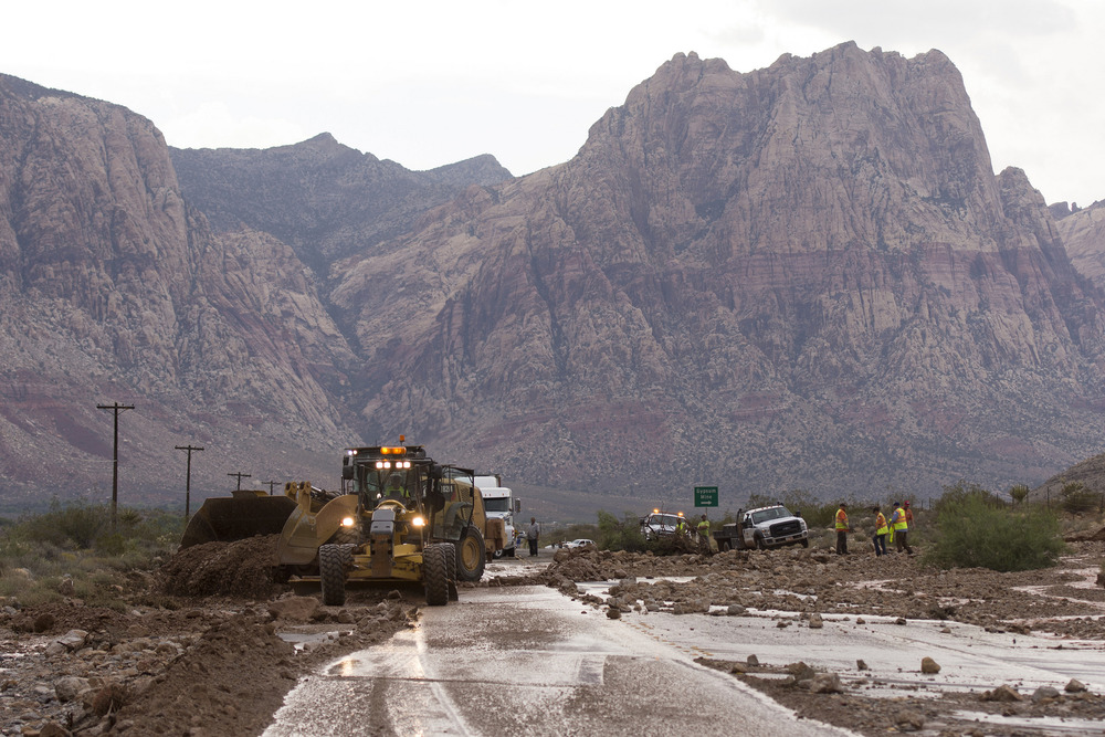 Crews on Highway 159 just South of Bonnie Springs in Red Rock Canyon National Conservation Area work to reopen the highway which is closed due to a washout Thursday, June 30, 2016. Jason Ogulnik/Las Vegas Review-Journal