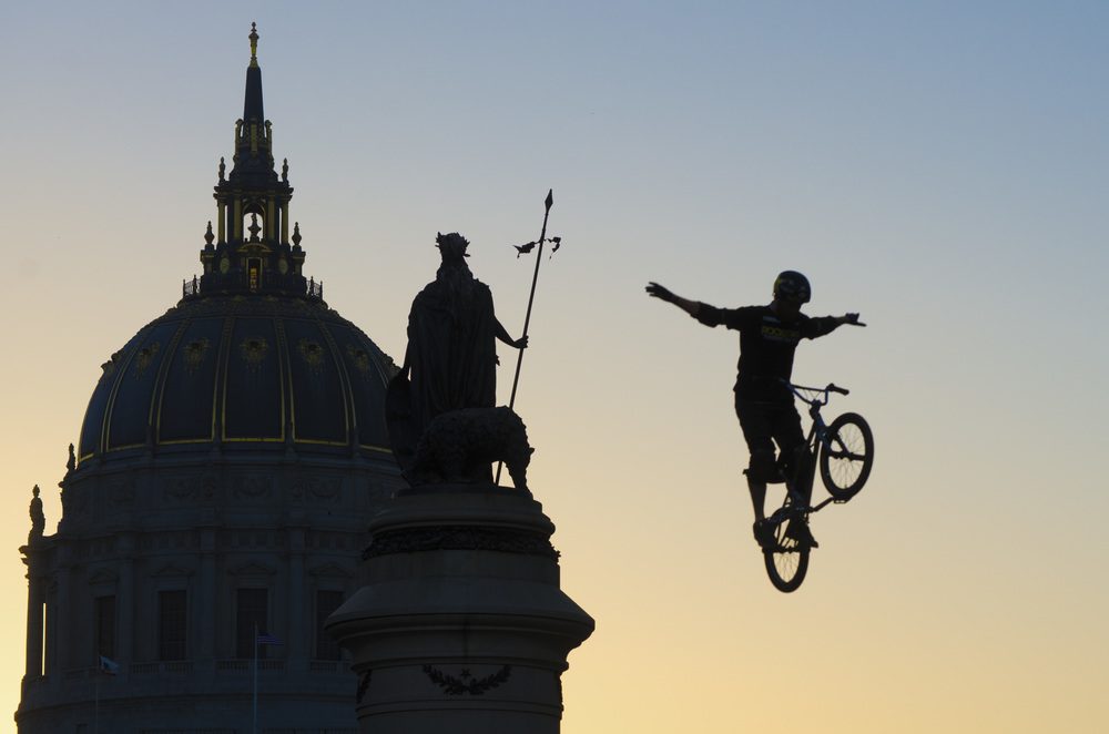 A bmx biker jumps a ramp while giving a demonstration outside of San Francisco's city hall during the Dew Tour on Saturday, Oct. 12, 2013.