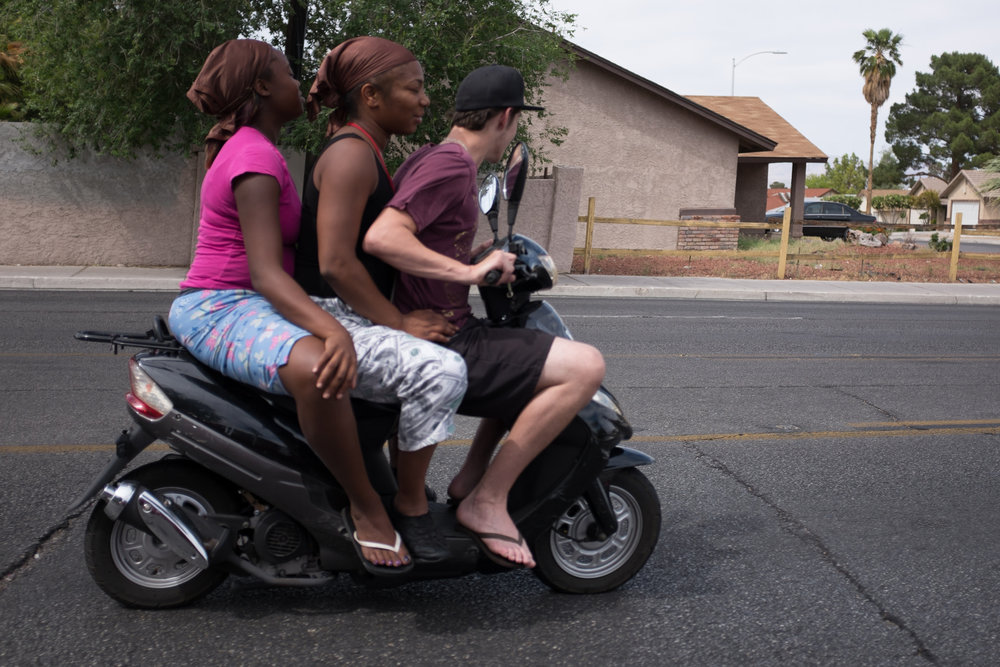 Three teens ride a moped on Washington Avenue at Woodbridge Drive in Las Vegas on Sunday, May 3, 2015.