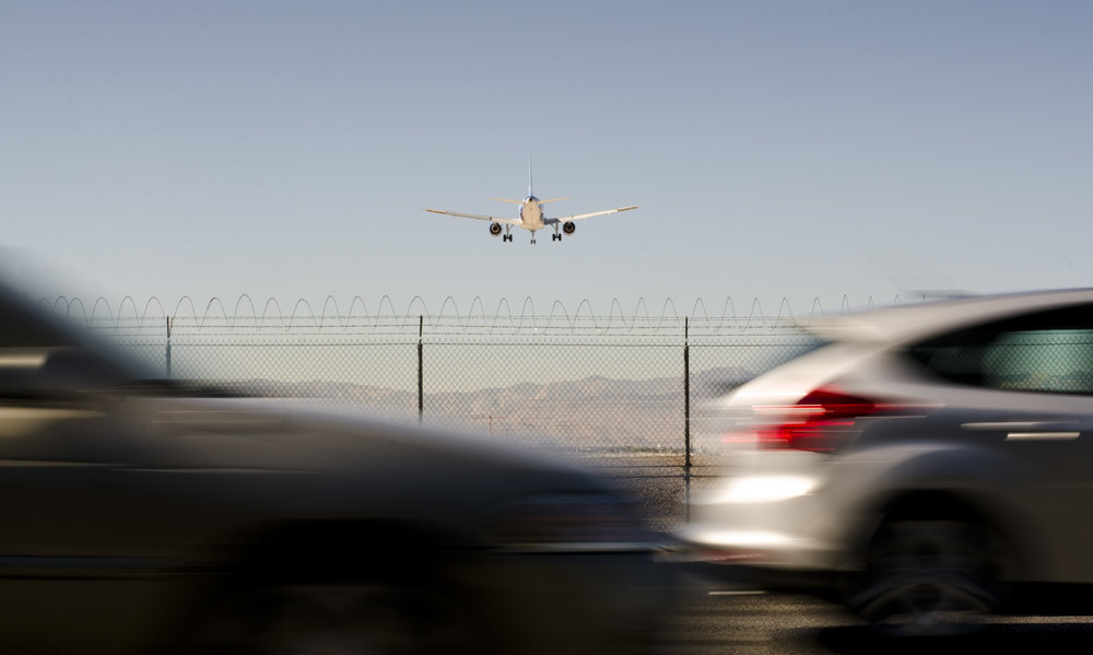 An airplane landing at McCarran International Airport is seen from Eastern Avenue in Las Vegas on Friday, Oct. 24, 2014.
