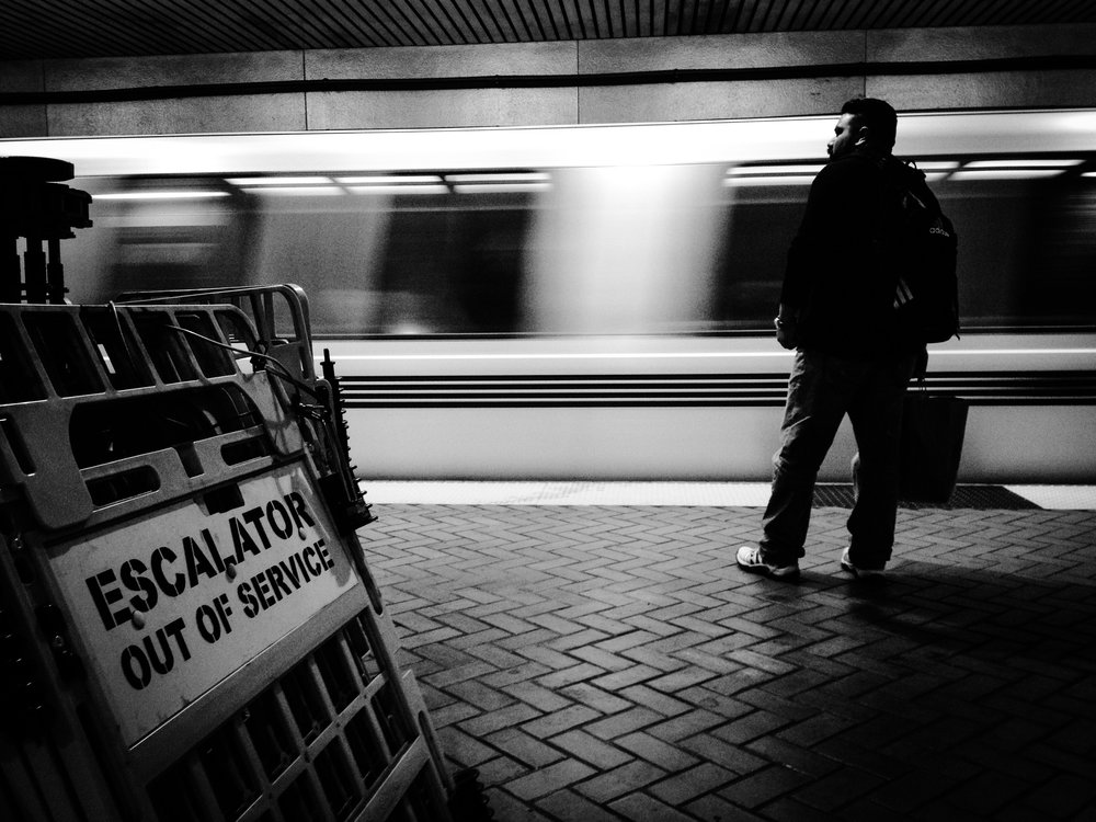 A man waits for a BART train in downtown San Francisco on Monday, Dec. 16, 2013.