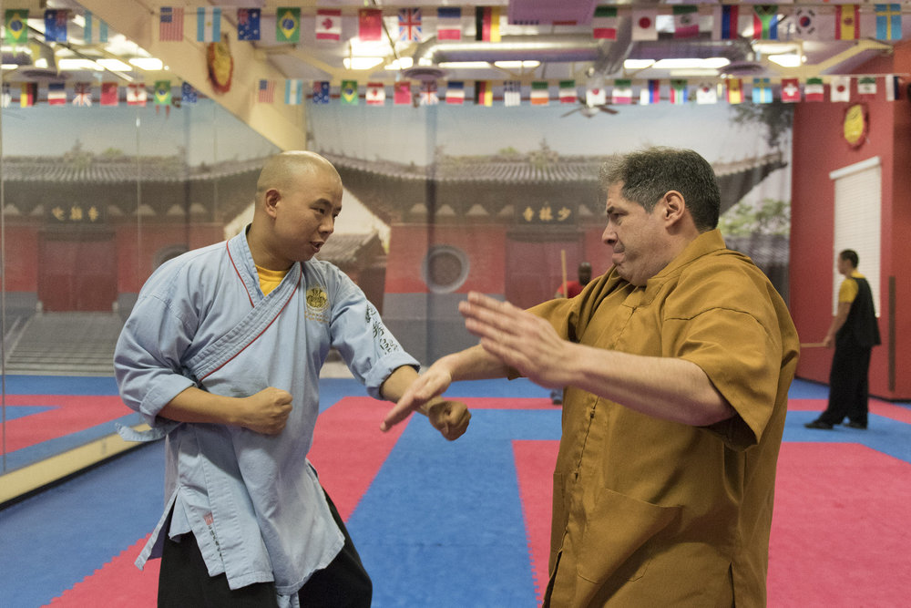 Rabbi Felipe Goodman, right, is given a kung fu lesson from shifu Shi Xing Wei at Shaolin Kungfu Chan in Las Vegas Friday, July 29, 2016. Rabbi Goodman does kung fu as a way to relieve workplace stress. Jason Ogulnik/Las Vegas Review-Journal