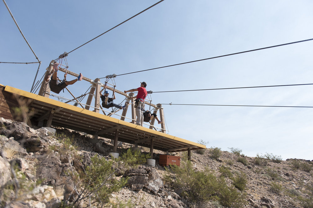 Jeffrey Grasso of Flightlinez Bootleg Canyon, third from left, leads a zip line tour group in Bootleg Canyon Mountain Bike Park in Boulder City, Wednesday, Aug. 17, 2016. Jason Ogulnik/Las Vegas Review-Journal