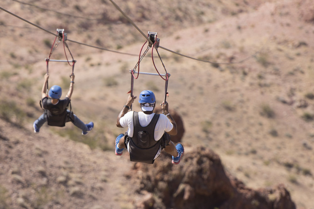 Tim Hicks, right, and his son, Ian Hicks, 13, left, of Seattle, ride a zip line in Bootleg Canyon Mountain Bike Park in Boulder City Wednesday, Aug. 17, 2016. The tour is led by Flightlinez Bootleg Canyon. Jason Ogulnik/Las Vegas Review-Journal