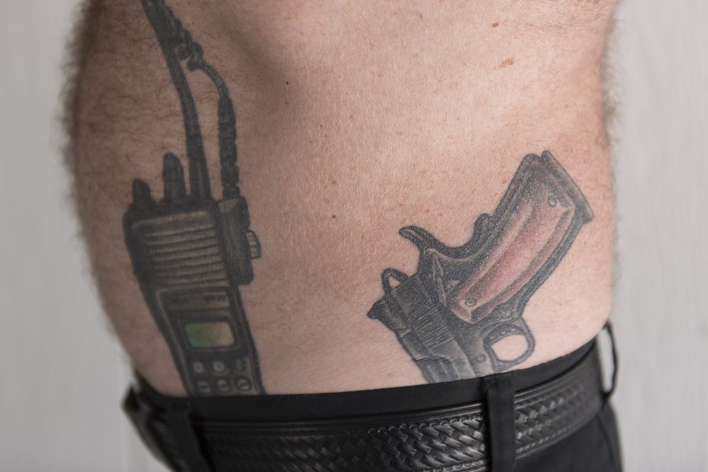 Retired Capitol Police officer and Nevada Highway Patrol trooper Brad Carson shows tattoos of a police radio and a Guncrafter Industries .50 caliber handgun at Carson's residence in Las Vegas Monday, Aug. 15, 2016. Carson deals with physical pain after being hit by a drunk driver while writing a ticket for another driver in 2004. Jason Ogulnik/Las Vegas Review-Journal