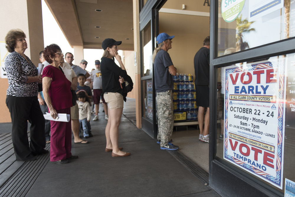 Voters stand in line for early voting at Albertsons at 2885 E. Desert Inn Rd. in Las Vegas, Saturday, Oct. 22, 2016. Jason Ogulnik/Las Vegas Review-Journal