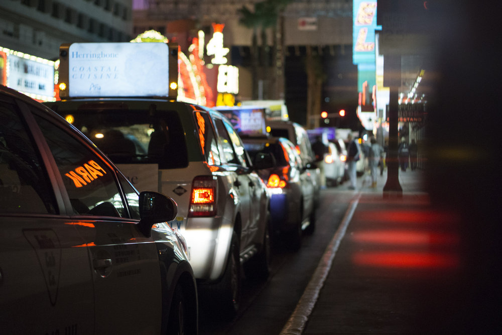 Taxis queue up on Casino Center Boulevard at Fremont Street in downtown Las Vegas, Jan. 17, 2016.