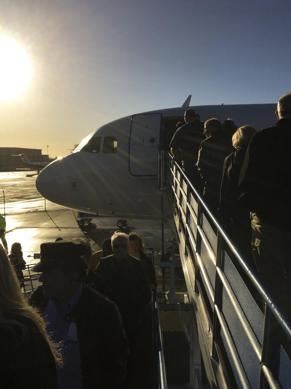 Passengers board Las Vegas bound Allegiant Air flight 124 at Sonoma County Airport in Santa Rosa, Calif., Sunday, Nov. 26, 2016.