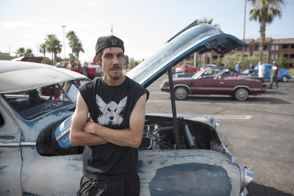 Robert Sewell poses with his Chrysler Windsor at the West End Boys car gathering in Las Vegas, Sunday, July 5, 2015.