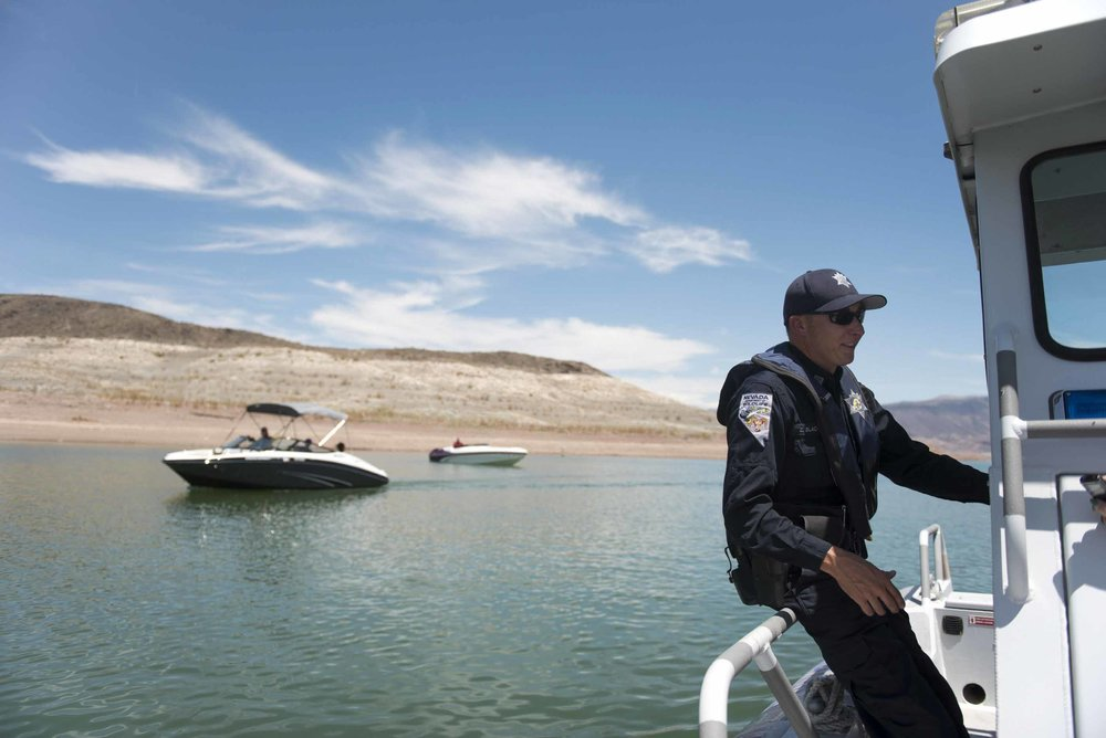 On Friday, July 3, 2015, near Boulder City, Nevada Department of Wildlife Game Warden Zach Blackwood gives a tour to show Lake Mead's receding waterline and the dangers it poses to boaters.