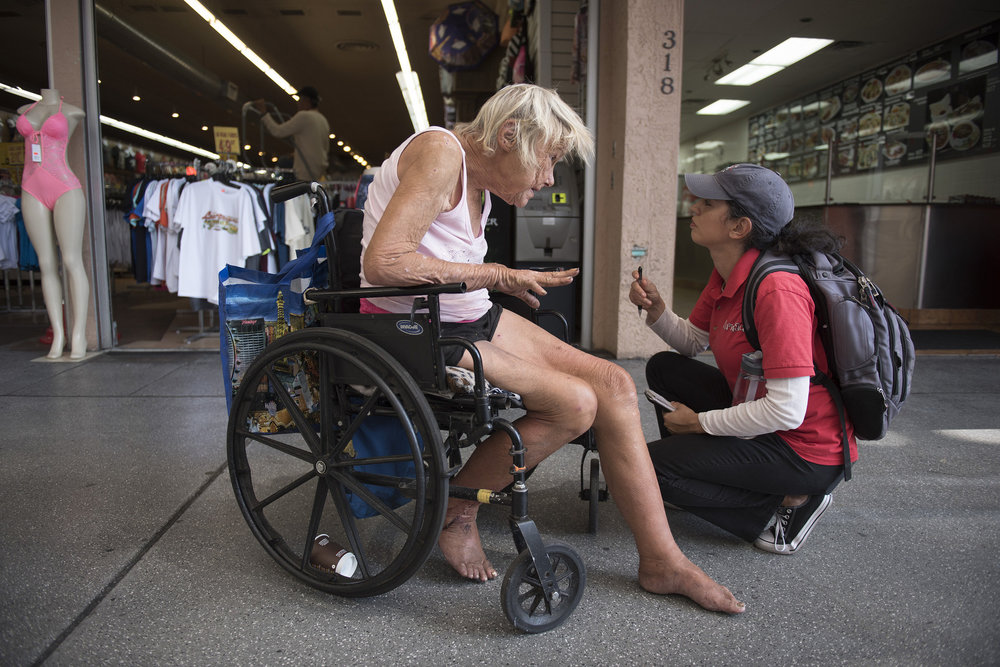 Linda Weston, left, speaks with Merideth Spriggs, founder of Caridad, at Fremont Street Experience in Las Vegas, Wednesday, Aug. 24, 2016. Caridad is an nonprofit organization which connects the homeless to resources. Jason Ogulnik/Las Vegas Review-Journal