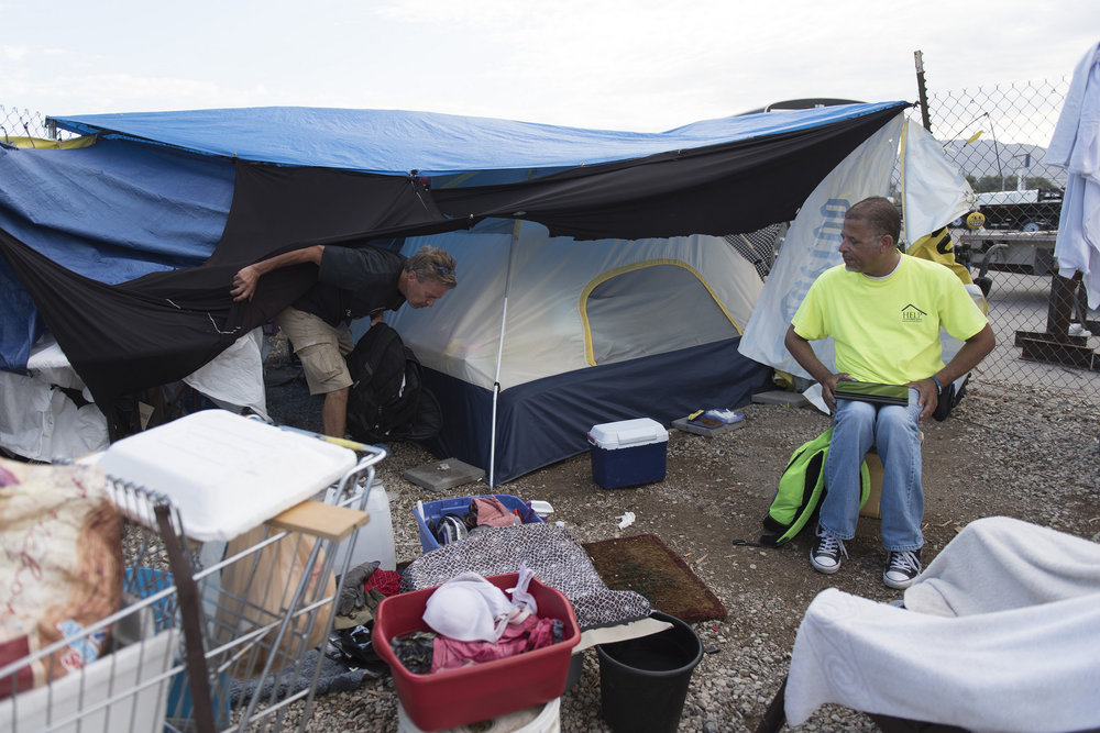 Lou Lacey, manager of the Mobile Crisis Intervention Team with Help of Southern Nevada, right, meets with homeless client Roy Knapp at Knapp's camp in order to connect him to resources, Las Vegas, Tuesday, Aug. 23, 2016. Jason Ogulnik/Las Vegas Review-Journal