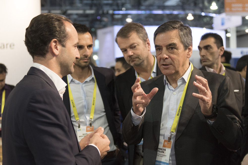 Francois Fillon, French Republican presidential candidate, right, views the Somfy Protect/ MyFox booth at the International Consumer Electronics Show (CES) in Las Vegas, Nevada, USA, 6 January, 2017. Jason Ogulnik/Sipa Press