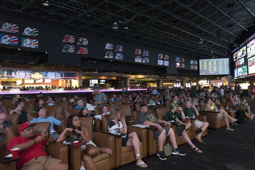 Guests track their bets as they watch Week 1 NFL games in the sports book at the Westgate Las Vegas Resort & Casino. Sept. 11, 2016. Jason Ogulnik for BuzzFeed News