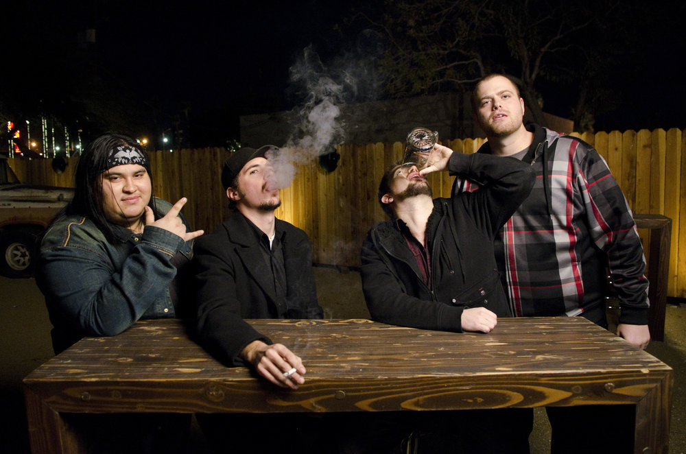 """Honor Amongst Thieves poses for a moment before one of their first shows at Bunkhouse Saloon in Las Vegas on Jan. 4, 2015. Tonight they release their debut full-length album """"Element of Truth"""" at the House of Blues in Las Vegas."""